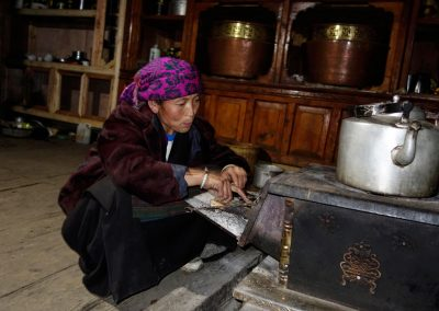 Feeding wood into a traditional wood stove