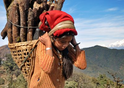 Young girl collecting firewood